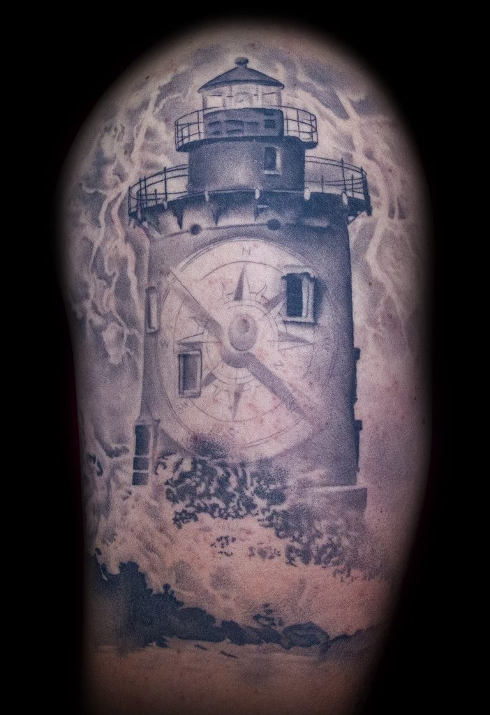 Emily Graven Tattoo Artist black and grey light house