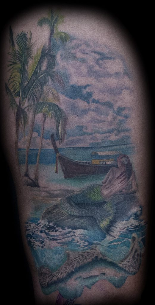 Emily Graven Tattoo Artist color mermaid and beach