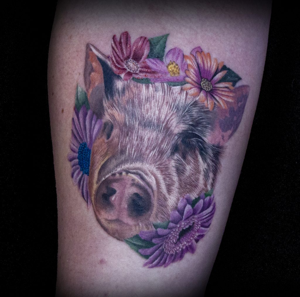Emily Graven Tattoo Artist color pig and flowers